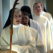 Sister Gail Fitzpatrick, the abbess of Our Lady of the Mississippi Abbey leads her community singing psalms at the early morning Lauds service.  The community of 22 Roman Catholic nuns follow Jesus Christ through a life of prayer, silence, simplicity and ordinary work.  Their home is a beautiful monastery which sits high on a bluff, overlooking the Mississippi River.