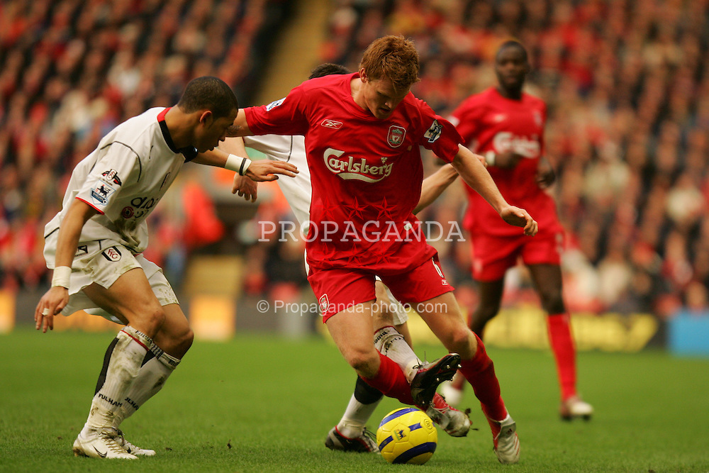 LIVERPOOL, ENGLAND - SATURDAY FEBRUARY 5th 2005: Liverpool's John Arne Risse tackled by Fulham's Liam Rosenior and Tomasz Radzinski during the Premiership match at Anfield. (Pic by David Rawcliffe/Propaganda)