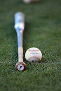 ANAHEIM, CA - JUNE 24:  A ball and bat lie on the grass during batting practice at the Colorado Rockies game against the Los Angeles Angels of Anaheim at Angel Stadium on Wednesday, June 24, 2009 in Anaheim, California.  The Angels defeated the Rockies 11-3.  (Photo by Paul Spinelli/MLB Photos via Getty Images)