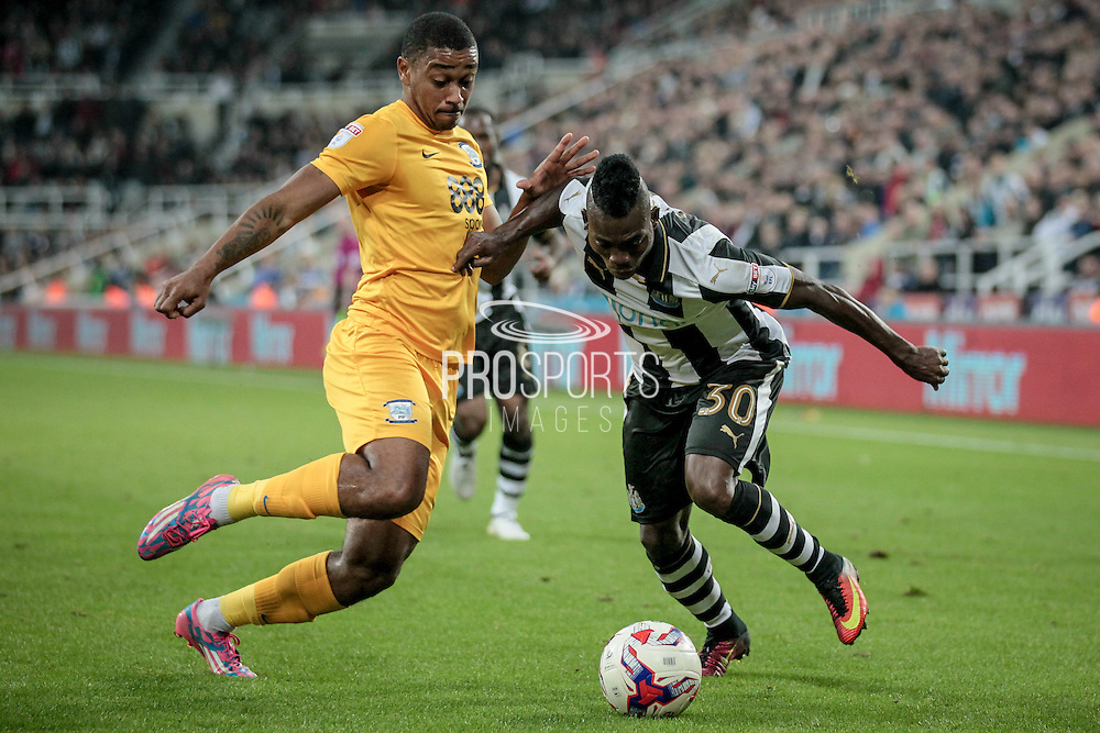 Chris Humphrey (Preston North End) challenges Christian Atsu (Newcastle United) during the EFL Cup 4th round match between Newcastle United and Preston North End at St. James's Park, Newcastle, England on 25 October 2016. Photo by Mark P Doherty.