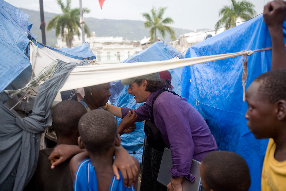 David Koubbi makes friends in a camp of people displaced by the earthquake. Koubbi, a French lawyer, is visiting Haiti to advocate to the Haitian government for passports for 56 children. The children were in the adoption process before the earthquake and though the adoptions have all been finalized, the children need passports before they can join their adopted families in France.