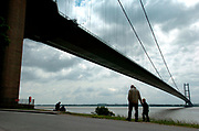 A parent and child take a walk under the Humber Bridge<br />Picture:Sean Spencer/hullnews.co.uk 01482 210267/07976 433960<br />www.hullnews.co.uk<br />©Sean Spencer/Hull News & Pictures Ltd<br />NUJ recommended terms & conditions apply. Moral rights asserted under Copyright Designs & Patents Act 1988. Credit is required. No part of this photo to be stored, reproduced, manipulated or transmitted by any means without permission.