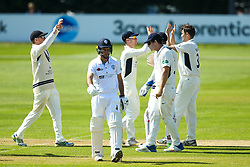 Wayne Madsen of Derbyshire cuts a dejected figure as he loses his wicket for 47 to Tim Murtagh of Middlesex who celebrates with teammates - Mandatory by-line: Robbie Stephenson/JMP - 20/04/2018 - CRICKET - The 3aaa County Ground  - Derby, England - Derbyshire CCC v Middlesex CCC - Specsavers County Championship Division Two