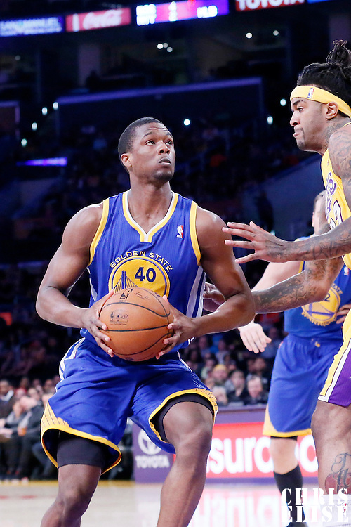 11 April 2014: Los Angeles Lakers forward Jordan Hill (27) defends on Golden State Warriors forward Harrison Barnes (40) during the Golden State Warriors 112-95 victory over the Los Angeles Lakers at the Staples Center, Los Angeles, California, USA.