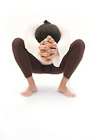 Anonymous woman squatting in body mind connection.