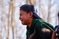 March 22, 2019 - Bandipora, Jammu and Kashmir, India - A Kashmiri boy seen crying after getting glimpse of Dead body of Slain Atif Shafi during his funeral at Hajin Village of north Kashmir's Bandipora, some 40 kms from summer capital Srinagar..Indian forces killed five militants and Atif Shafi an 11 year old hostage during seperate gunfights in Kashmir, India police said. (Credit Image: © Idrees Abbas/SOPA Images via ZUMA Wire)