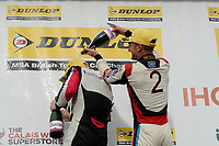 #22 Chris Smiley BTC Norlin Racing Honda Civic Type R (FK2) and #2 Colin Turkington Team BMW BMW 125i M Sport during Race Three Podium Celebrations,  during BTCC Race 2  as part of the Dunlop MSA British Touring Car Championship - Rockingham 2018 at Rockingham, Corby, Northamptonshire, United Kingdom. August 12 2018. World Copyright Peter Taylor/PSP. Copy of publication required for printed pictures.