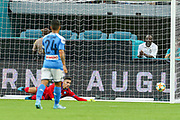 FC Barcelona midfielder Sergio Busquets (5) scores the first goal of the game when SSC Napoli goalkeeper Alex Meret (1) cannot make the save during a La Liga-Serie A Cup soccer match, Wednesday, Aug. 7, 2019, in Miami Gardens, Fla. FC Barcelona beat Napoli 2-1 (Kim Hukari/Image of Sport)