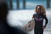Rob Machado heads down the beach in front of a massive crowd to surf in an All-Star expression session at the US Open of Surfing in Huntington Beach, Calif., on Saturday, Aug. 6, 2011.  (Photo by Aaron Schmidt © 2011)