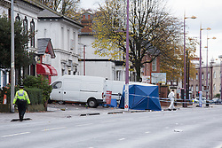 © Licensed to London News Pictures. 30/10/2015. Handsworth, Birmingham, UK. The scene on the Soho Road, Handsworth, Birmingham where a double shooting took place in the early hours of this morning. Photo credit : Dave Warren/LNP