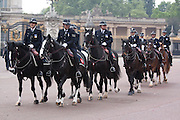Mounted police leave Buckingham Palace on the day of the Royal wedding between Prince William and Catherine Middleton, London, United Kingdom.