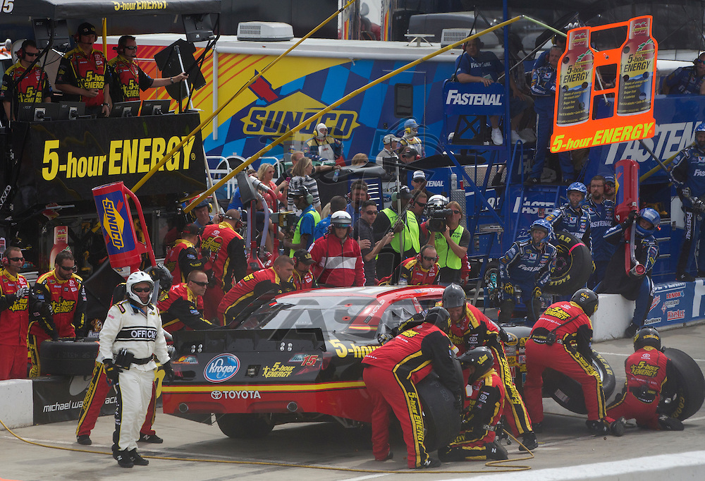 Martinsville, VA - APR 01, 2012:  Clint Bowyer (15) comes in for a pit stop during the Goody's Fast Relief 500 race at the Martinsville Speedway in Martinsville, VA.