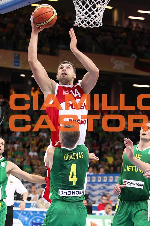 DESCRIZIONE : Panevezys Lithuania Lituania Eurobasket Men 2011 Preliminary Round Polonia Lituania Poland Lithuania<br /> GIOCATORE : Adam Hrycaniuk <br /> SQUADRA : Polonia Poland<br /> EVENTO : Eurobasket Men 2011<br /> GARA : Polonia Lituania Poland Lithuania<br /> DATA : 01/09/2011 <br /> CATEGORIA : tiro shot<br /> SPORT : Pallacanestro <br /> AUTORE : Agenzia Ciamillo-Castoria/ElioCastoria<br /> Galleria : Eurobasket Men 2011 <br /> Fotonotizia : Panevezys Lithuania Lituania Eurobasket Men 2011 Preliminary Round Polonia Lituania Poland Lithuania<br /> Predefinita :