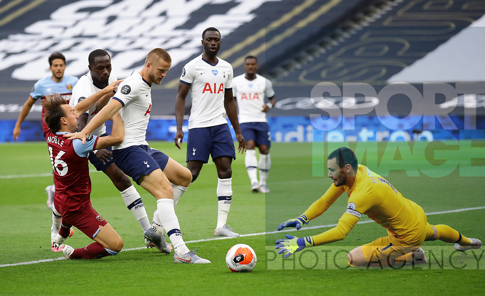 Mark Noble of West Ham United is blocked by Eric Dier of Tottenham as Hugo Lloris of Tottenham collects the ball during the Premier League match at the Tottenham Hotspur Stadium, London. Picture date: 23rd June 2020. Picture credit should read: David Klein/Sportimage