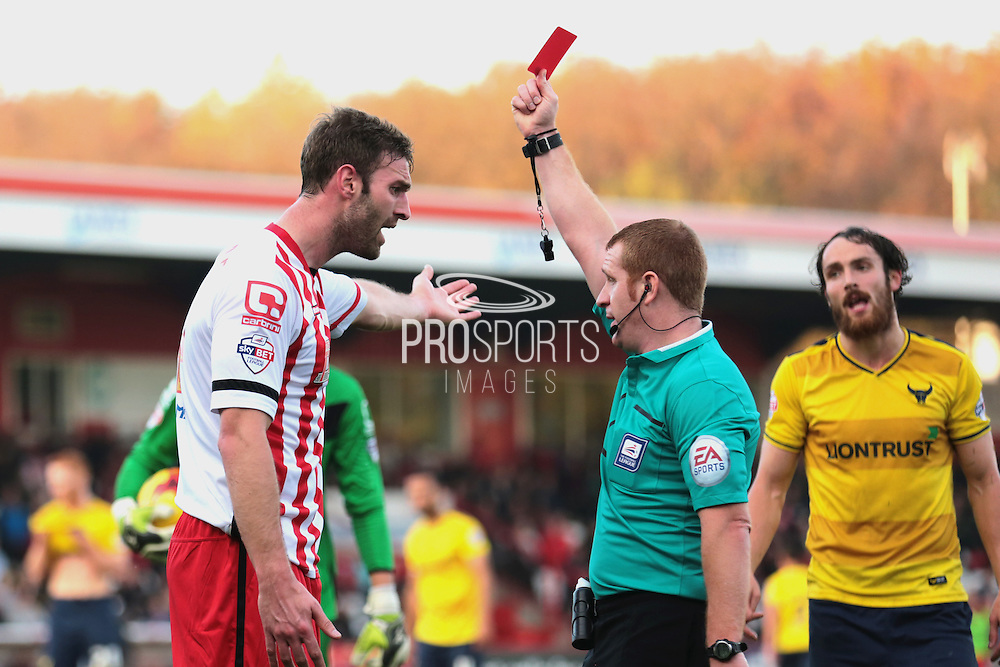 Stevenage FC defender Jamie McCombe is shown a red card for a tackle on Oxford United forward Danny Hylton during the Sky Bet League 2 match between Stevenage and Oxford United at the Lamex Stadium, Stevenage, England on 31 October 2015. Photo by Jemma Phillips.