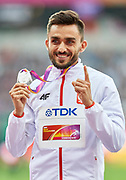 Great Britain, London - 2017 August 09: Adam Kszczot (RKS Lodz) of Poland celebrates his silver medal in men&rsquo;s 800 meters while awarding ceremony during IAAF World Championships London 2017 Day 6 at London Stadium on August 09, 2017 in London, Great Britain.<br /> <br /> Mandatory credit:<br /> Photo by &copy; Adam Nurkiewicz<br /> <br /> Adam Nurkiewicz declares that he has no rights to the image of people at the photographs of his authorship.<br /> <br /> Picture also available in RAW (NEF) or TIFF format on special request.<br /> <br /> Any editorial, commercial or promotional use requires written permission from the author of image.