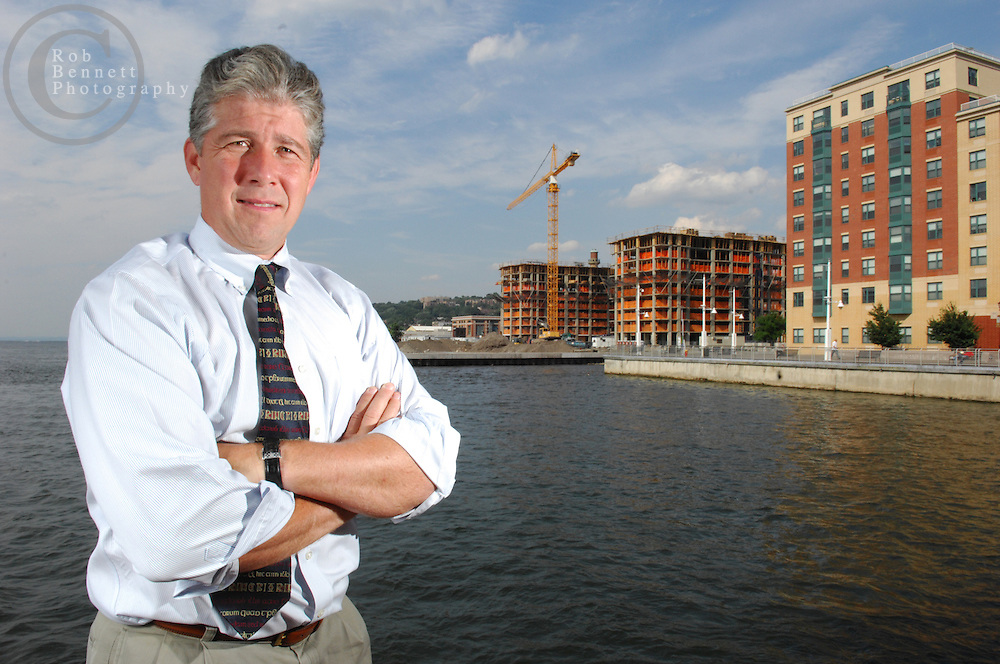 Yonkers, NY - Tuesday, July 24, 2007 - Portrait of developer Arthur Collins - Arthur Collins, 52, President of Collins Enterprises, poses for a portrait on the Yonkers Recreation Pier on the Yonkers river-front Tuesday afternoon. Seen in the background, under construction, is Hudson Park North which is being built on a brownfield reclamation site...Credit: Rob Bennett for The New York Times.