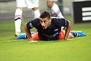 Younes Belhanda of Montpellier reacts as he is fouled during the Champions League group match between Montpellier and Arsenal at the Stade la Mosson, Montpellier, France, 18th September 2012. Eoin Mundow/Cleva Media
