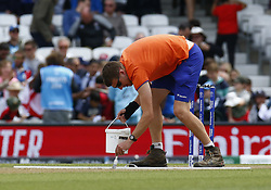 May 27, 2019 - London, England, United Kingdom - Groundsmen painting wicket.during ICC Cricket World Cup - Warm - Up between England and Afghanistan at the Oval Stadium , London,  on 27 May 2019. (Credit Image: © Action Foto Sport/NurPhoto via ZUMA Press)