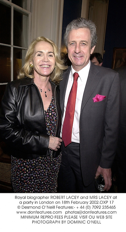 Royal biographer ROBERT LACEY and MRS LACEY at a party in London on 18th February 2002.OXP 17