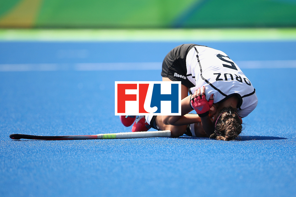 RIO DE JANEIRO, BRAZIL - AUGUST 17:  Selin Oruz of Germany holds her shoulder as she lies on the ground after being hit by the ball during the womens semifinal match between the Netherlands and Germany on Day 12 of the Rio 2016 Olympic Games at the Olympic Hockey Centre on August 17, 2016 in Rio de Janeiro, Brazil.  (Photo by Mark Kolbe/Getty Images)