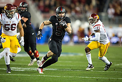 SANTA CLARA, CA - DECEMBER 05:  Running back Christian McCaffrey #5 of the Stanford Cardinal rushes up field against the USC Trojans during the first quarter of the Pac-12 Championship game at Levi's Stadium on December 5, 2015 in Santa Clara, California. (Photo by Jason O. Watson/Getty Images) *** Local Caption *** Christian McCaffrey