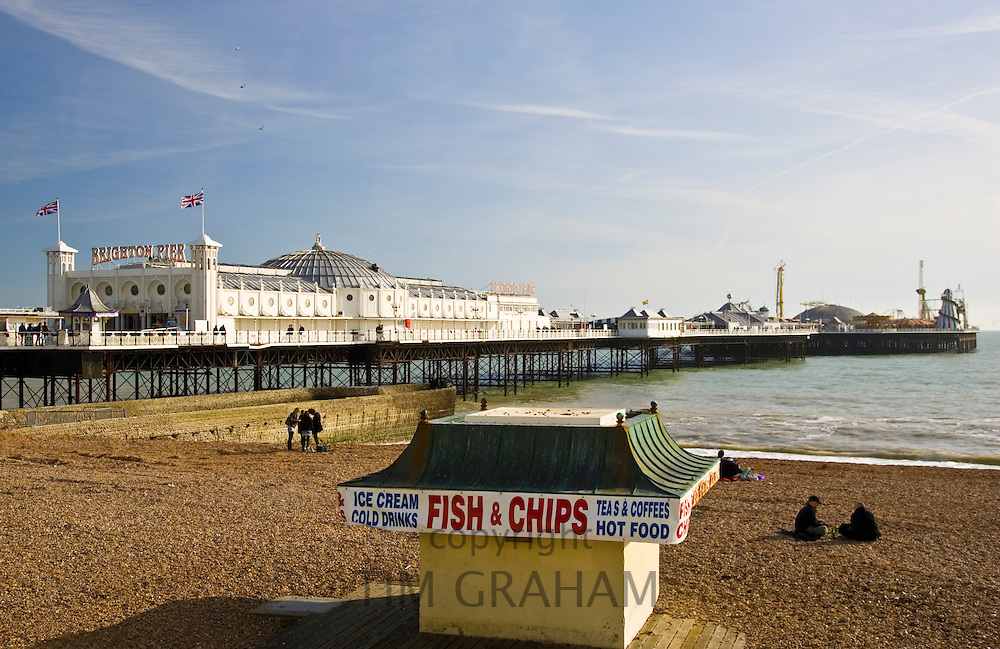 Fish and chip shop on beach by Brighton Pier on the South Coast of England, United Kingdom