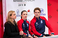 KELOWNA, BC - OCTOBER 25: American ice dancers Caroline Green and Michael Parsons await their score for the rhythm dance at Skate Canada International held at Prospera Place on October 25, 2019 in Kelowna, Canada. (Photo by Marissa Baecker/Shoot the Breeze)