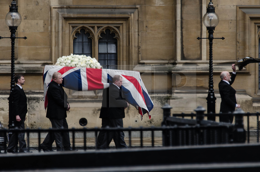© Licensed to London News Pictures. 17/04/2013. London, UK. The body of the late Baroness Margaret Thatcher is carried from Chapel of St Mary Undercroft in the Palace of Westminster to the waiting hearse, when it will be taken to St Paul's Cathedral.  Photo credit : Richard Isaac/LNP