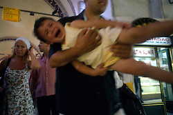 TURKEY ISTANBUL JUL02 - A screaming child is carried out of the Kapali Carsi, the largest covered bazaar in the world. It features over 4000 shops, numerous storehouses, moneychangers and banks, a police station, a mosque, private security guards and its own health centre. ..jre/Photo by Jiri Rezac..© Jiri Rezac 2002..Contact: +44 (0) 7050 110 417.Mobile:   +44 (0) 7801 337 683.Office:    +44 (0) 20 8968 9635..Email:     jiri@jirirezac.com.Web:     www.jirirezac.com