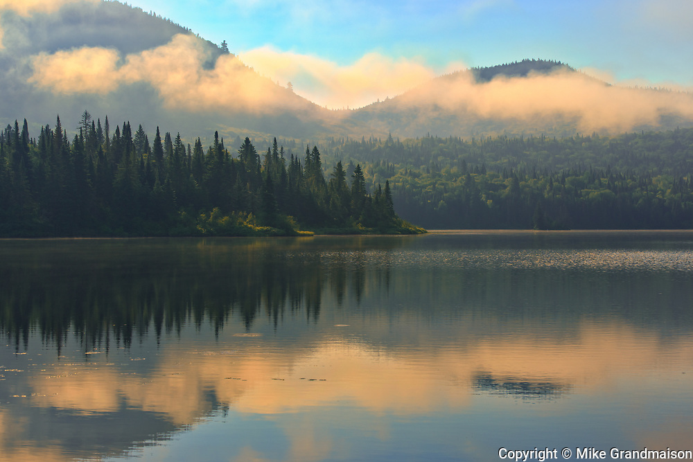 Fog and reflection on Lac La Joie at sunrise<br />