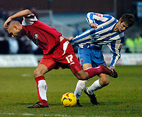 Photo: Leigh Quinnell.<br /> Hartlepool United v Swindon Town. Coca Cola League 1.<br /> 02/01/2006. Swindons Charlie Comyn-Platt gets shirty with Hartlepools Anthony Sweeney.