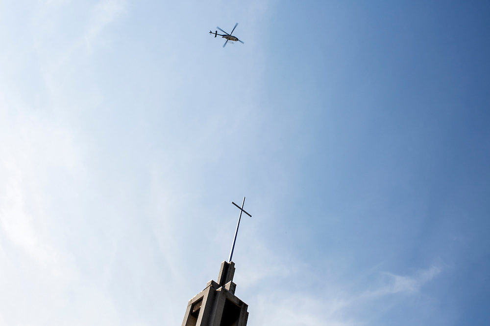 A police helicopter flies over the city center ahead of the Democratic National Convention on Monday, September 3, 2012 in Charlotte, NC.