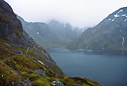 Misty rain falls on Lake Harris and Mount Xenicus on the Routeburn Track, Mount Aspiring National Park, New Zealand. In 1990, UNESCO honored Te Wahipounamu - South West New Zealand as a World Heritage Area.
