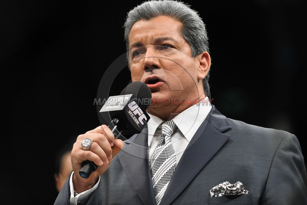 "COLOGNE, GERMANY, JUNE 13, 2009: Bruce Buffer announces the start of the live broadcast segment during ""UFC 99: The Comeback"" inside LanXess Arena, Cologne"