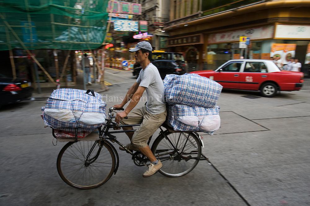 Hongkong, transportation by bicycle in Yau Ma Tei.