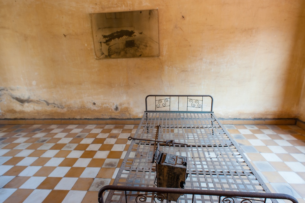 Bed in cell torture at Tuol Sleng Khmer Rouge Prison in Phnom Penh (Cambodia).
