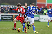 Carlisle United Gary Liddle and Accrington Stanley Shay McCartan battle during the EFL Sky Bet League 2 match between Accrington Stanley and Carlisle United at the Fraser Eagle Stadium, Accrington, England on 21 January 2017. Photo by Pete Burns.