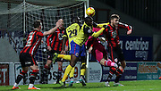 Dagenham and Redbridge Defender Ayo Obileye challenges Tony Thompson during the Sky Bet League 2 match between Morecambe and Dagenham and Redbridge at the Globe Arena, Morecambe, England on 1 December 2015. Photo by Pete Burns.