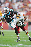 LANDOVER, MD - NOVEMBER 26:  Cornerback Kenny Wright #25 of the Washington Redskins jacks up wide receiver Drew Carter #18 of the Carolina Panthers after Carter catches a pass at FedExField on November 26, 2006 in Landover, Maryland. The Redskins defeated the Panthers 17-13. ©Paul Anthony Spinelli *** Local Caption *** Kenny Wright;Drew Carter