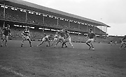 M. Byrne of Offaly in possession with S. Crawley and P. Lyne of the Cork Back line during the All Ireland Minor Gaelic Football final Cork V. Offaly in Croke Park on 27th September 1964.