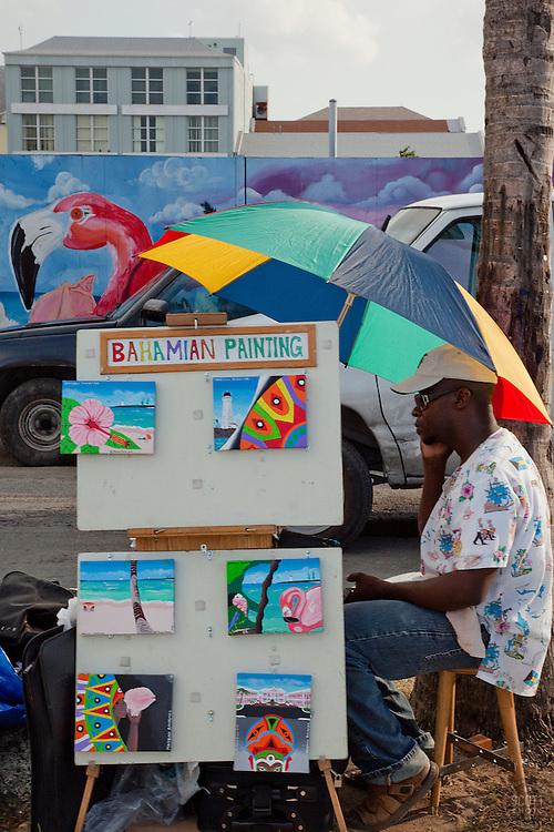 Bahamian man selling his colorful Bahamian paintings in the Bahamas.