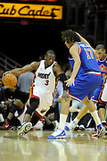 Feb 4, 2010; Cleveland, OH, USA; Miami Heat guard Dwyane Wade (3) drives past Cleveland Cavaliers forward Anderson Varejao (17) during the first quarter at Quicken Loans Arena. Mandatory Credit: Jason Miller-US PRESSWIRE