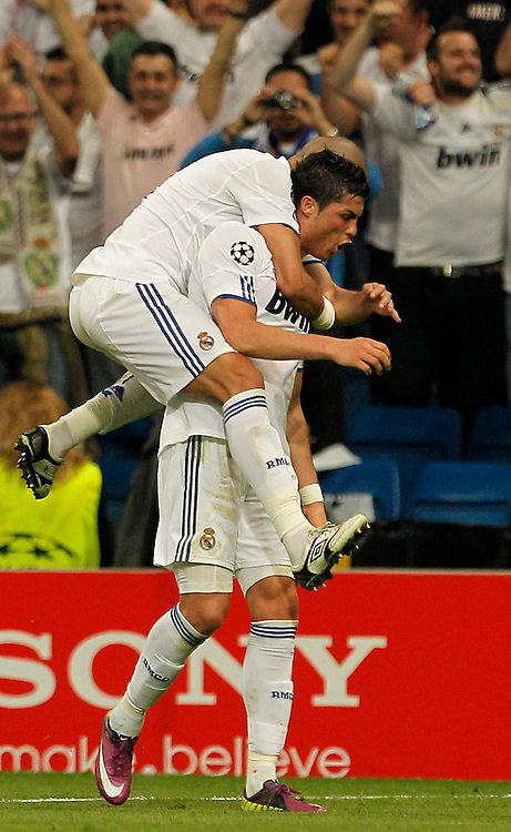 Real Madrid's Cristiano Ronaldo from Portugal, bottom, reacts after scoring against Tottenham Hotspur with Pepe from Portugal, top, during a quarter final, 1st leg Champions League soccer match at the Santiago Bernabeu stadium in Madrid, Tuesday, April 5, 2011.