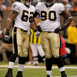 2009 August 14: New Orleans Saints linebacker Jonathan Casillas (62) and defensive tackle DeMario Pressley (90) on the field during 17-7 win by the New Orleans Saints over the Cincinnati Bengals in their preseason opener at the Louisiana Superdome in New Orleans, Louisiana.