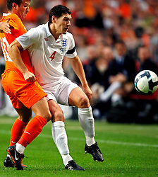 Gareth Barry defends during the International Friendly between Netherlands and England at the Amsterdam Arena on August 12, 2009 in Amsterdam, Netherlands.