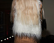 Summer Reling, 20, of St. Petersburg, Fla. lets her blonde locks fall against her furry vest. Christian Fashion Week 2015 culminated with designer fashion during a runway show at The Vault in Tampa, Fla. (Photo by MELISSA LYTTLE / 2/20/15)