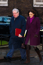 London, February 3rd 2015. Members of the cabinet gather at Downing Street for their weekly meeting. PICTURED: Patrick McLoughlin, Secretary of State for Transport arrives at No 10 with Theresa Villiers, Secretary of State for Northern Ireland