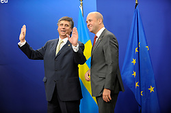 Jan Fischer, prime minister of the Czech Republic, left, shares a laugh with Fredrik Reinfeldt, Sweden's prime minister and standing president of the European Council, as he arrives for the European Summit at the EU headquarters in Brussels, Belgium, on Thursday, Sept. 17, 2009. European Union leaders may call for sanctions on banks that pay excessive bonuses, fearing that runaway executive pay could trigger another financial crisis, a draft text showed. (Photo © Jock Fistick) *** Local Caption ***Jan Fischer