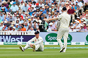 Keaton Jennings of England sits on the grass after missing a difficult wicket taking catch during second day of the Specsavers International Test Match 2018 match between England and India at Edgbaston, Birmingham, United Kingdom on 2 August 2018. Picture by Graham Hunt.